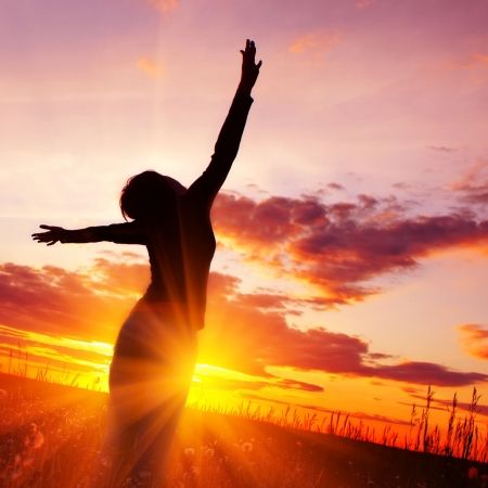 Young person stretching at sunrise - find joy and purpose in life again with depression counselling - see Sarah Tuckett Psychotherapy and Counselling North Brisbane