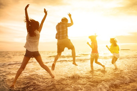 People jumping for joy at the beach - learn how to get your mojo back and lessen the grip of depression -  contact Sarah Tuckett Psychotherapy and Counselling North Brisbane for depression counsellling