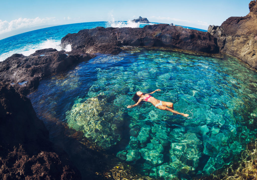 Woman floating in calm rockpool - see if anxiety counselling with Sarah Tuckett Psychotherapy and Counselling North Brisbane can help you find  your inner calm